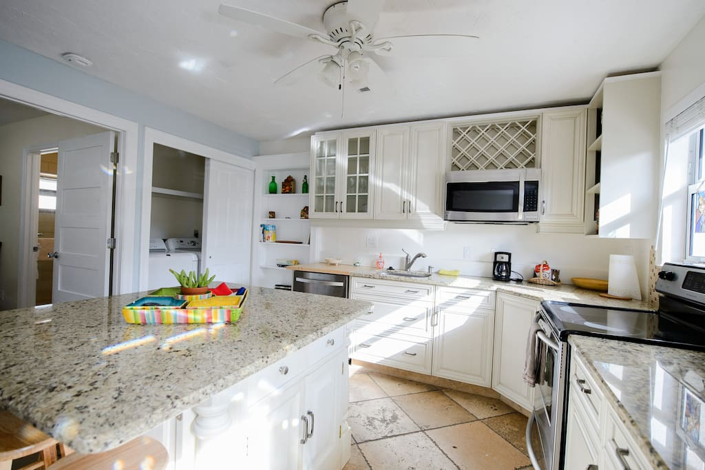Fully equipped kitchen with Dishwasher, Electric Stove, Refrigerator w/freezer and water/ice dispenser, Microwave oven