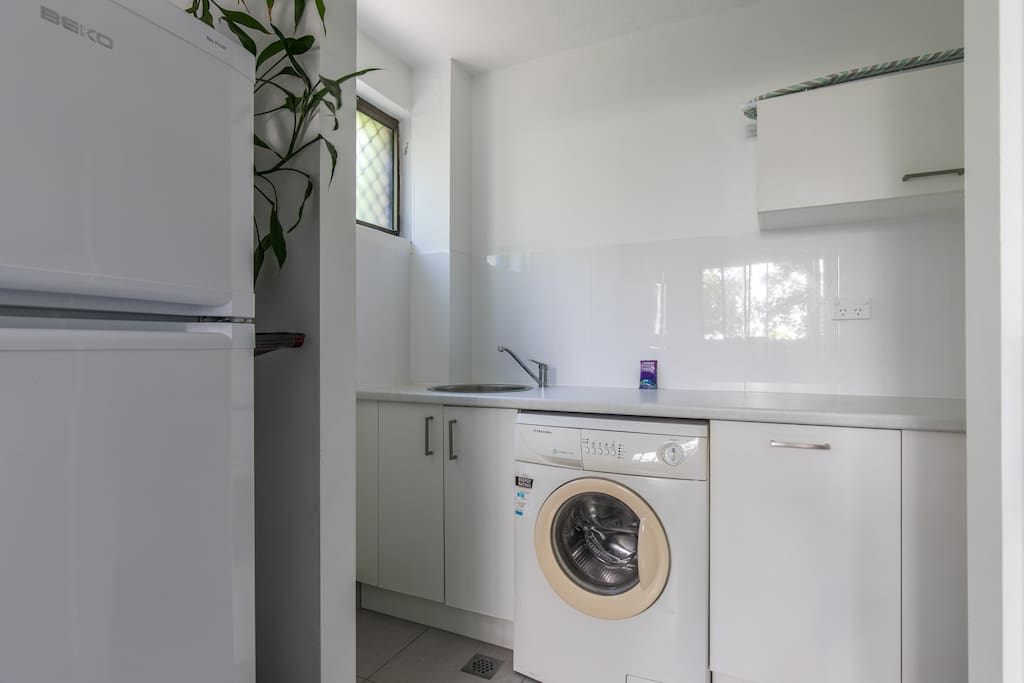 This is the utility room with washing machine, under mount sink etc. Equipped with ironing board, iron, washing powder etc.