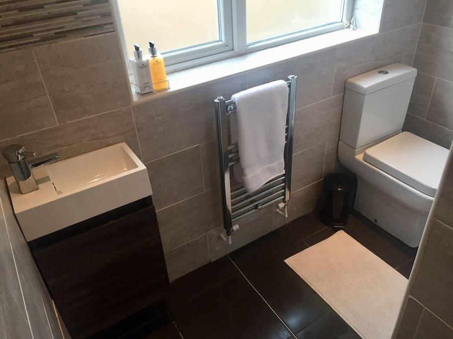 Private bathroom with underfloor heating and heated towel rail