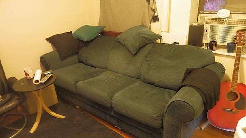 Shared living room. TV on opposite wall