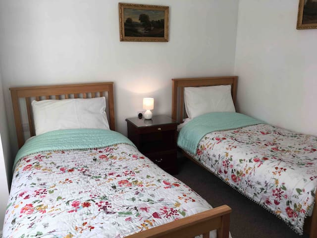 Bedroom with  two single beds.