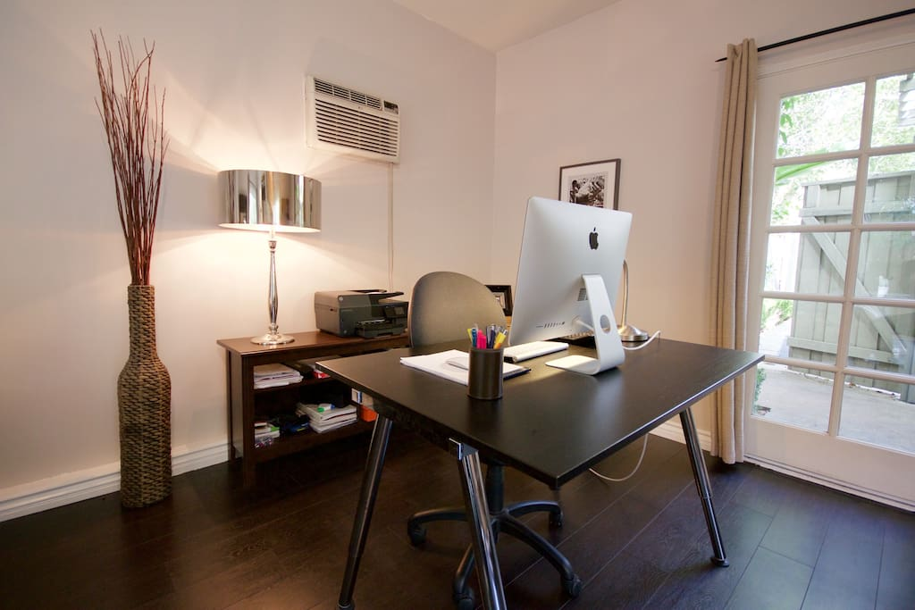 Office area with Desk and printer available.