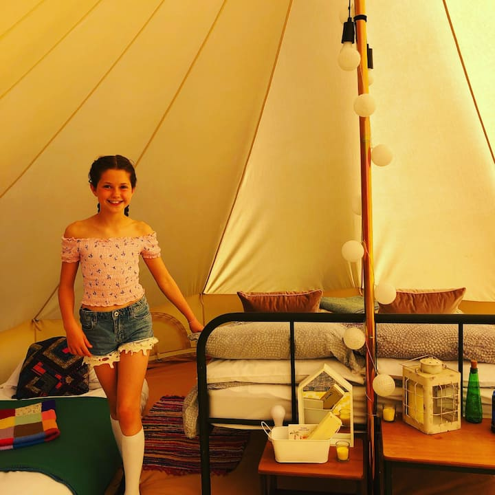 Spend time under the stars with your own bell tent and fire pit (sleeps 4)