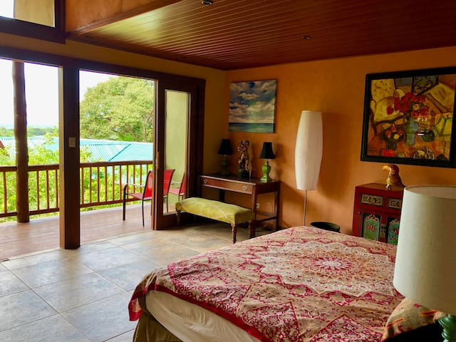 This ocean view bedroom includes a king size bed and private balcony.