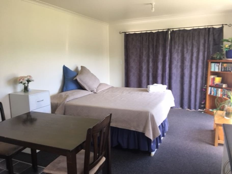 The room is spacious with draws, wardrobe and pantry space.