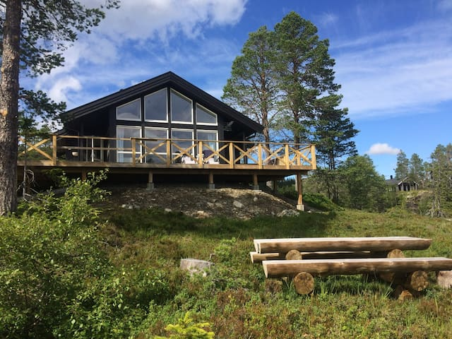 New cabin with great views - 30m from airport.