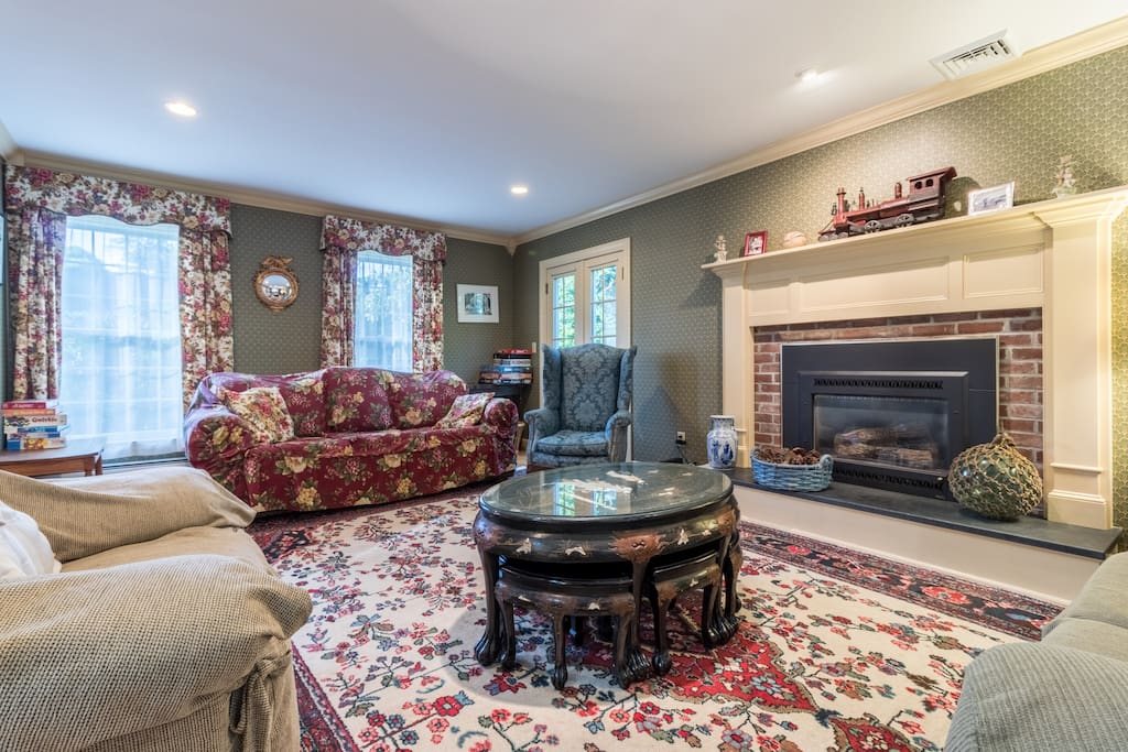 Spacious living area with a brick gas fireplace.
