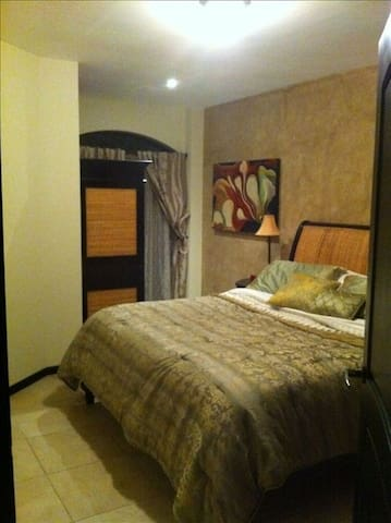 Guest King Bedroom walk in closet, a/c, balcony, and TV  with cable