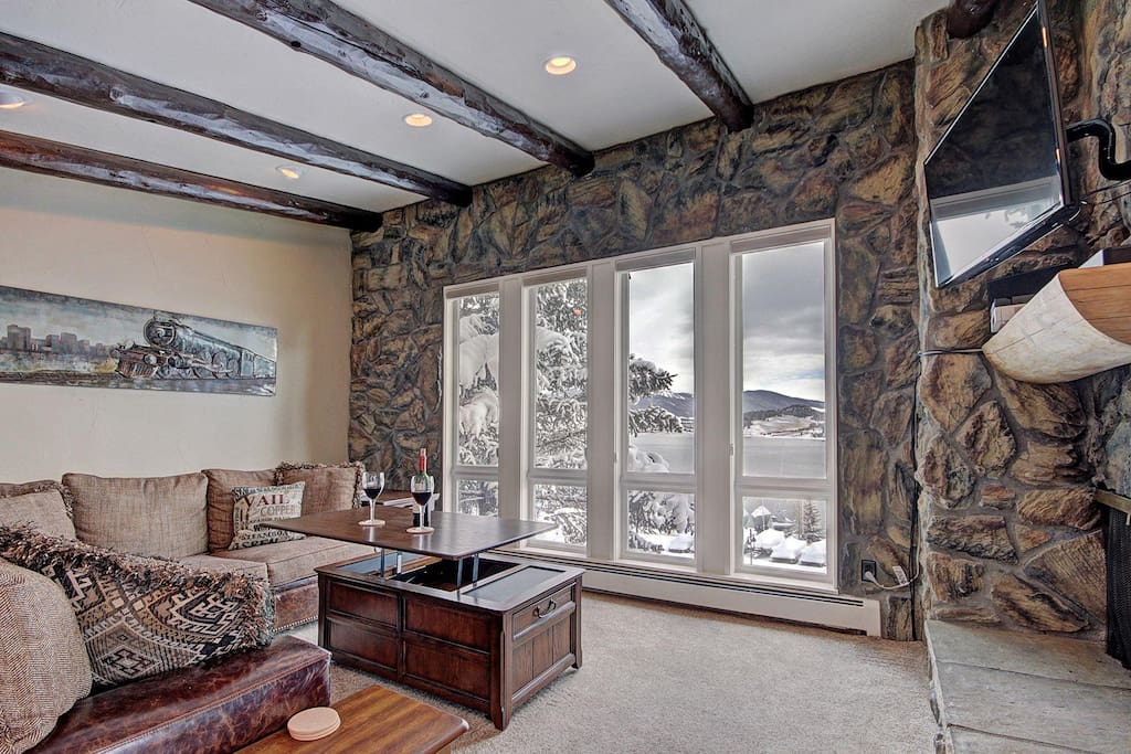 Remodeled & spacious living area with stunning lake & mountain views - Stunning lake and mountain views from living area.