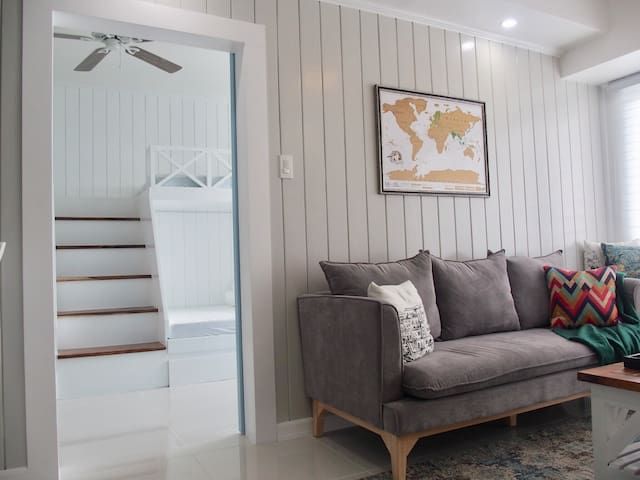 Adjacent units connected by a stylish, barn-inspired door