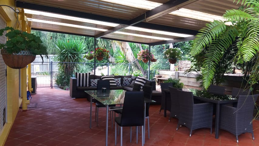 Relax in covered outdoor area.