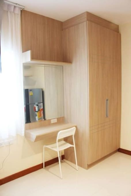 The rom has closet , fridge and small desk