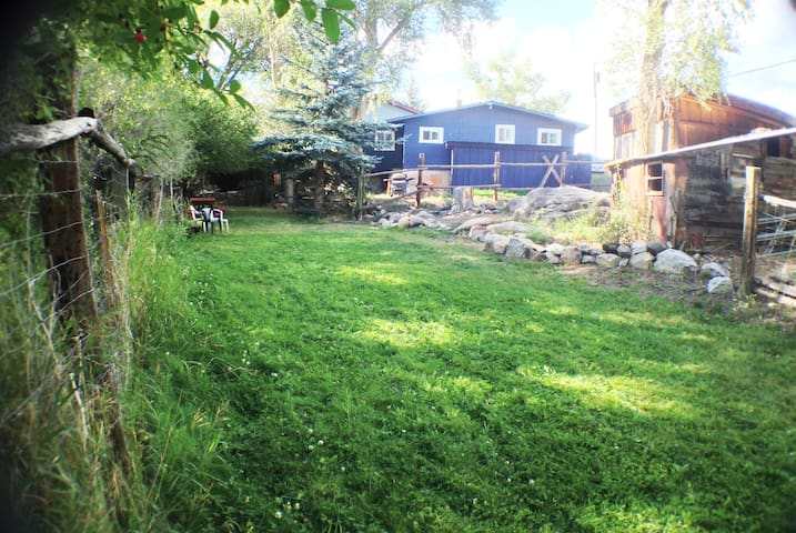 Backyard run along the creek, nice open space.  Across the creek is a park. Click on this pic to see complete slide show of house and grounds.