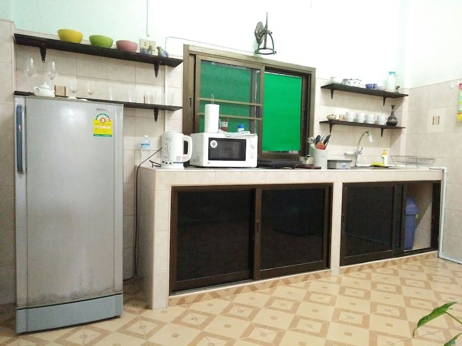 The kitchen come with kitchenware: Toaster,refrigerator, microwave,  kettle,  washing machine,  rice cooker,  induction cooker