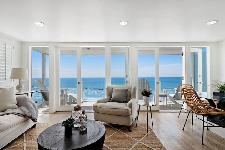 Chic oceanfront cottage w/ deck, multiple balconies - steps from private beach!