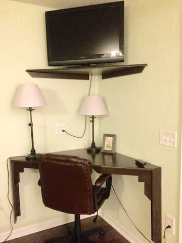 Nice desk area with comfortable chair. TV and internet