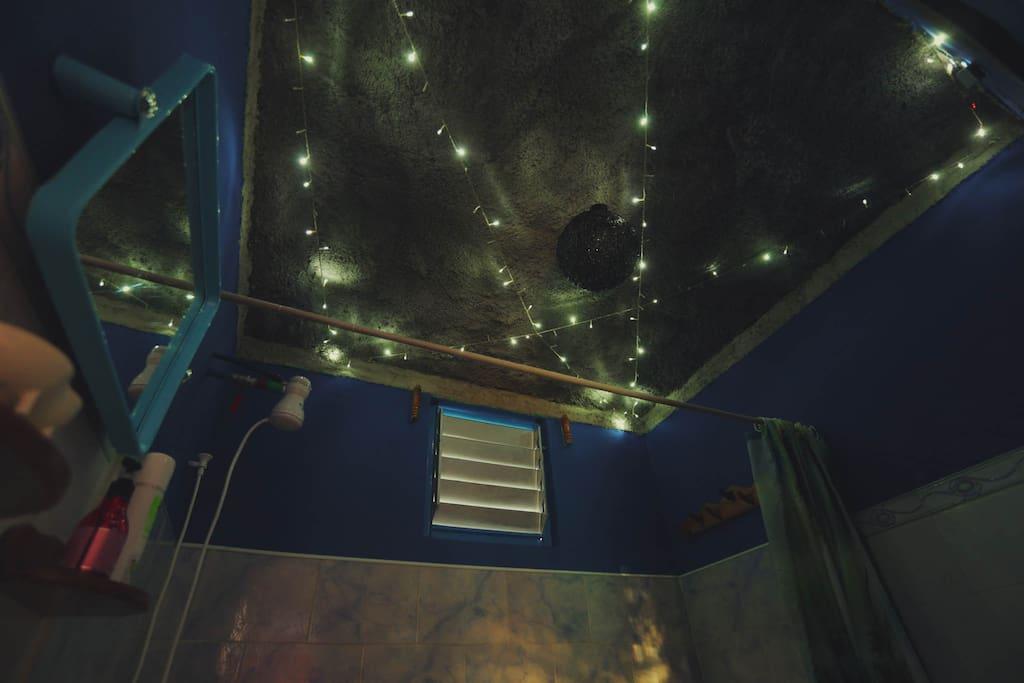 Shower under the starry night sky