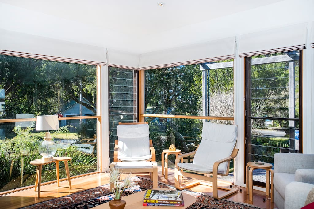 Loungeroom with floor to ceiling windows