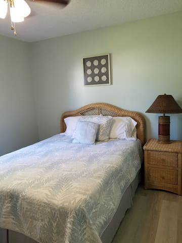 Bedroom 1 has a queen size mattress and a ceiling fan.
