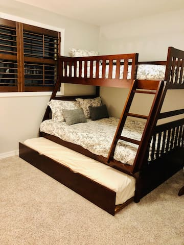 Perfect room for the kids!  The third bedroom has a twin bunk over a full size bed, with a twin trundle  bed underneath.