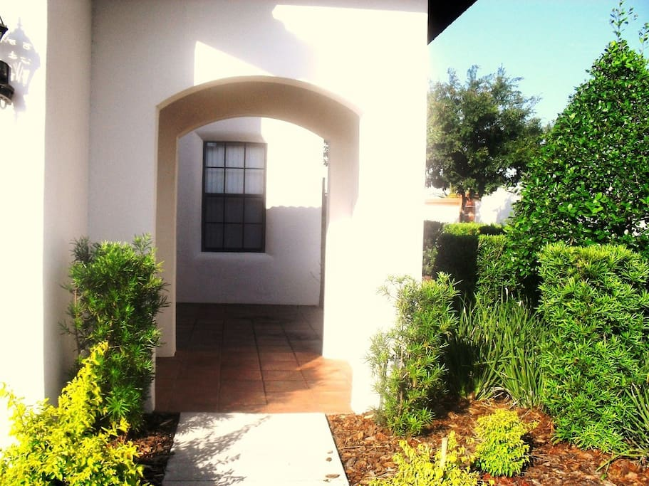 Enter the Mediterranean style front courtyard via an imposing archway.