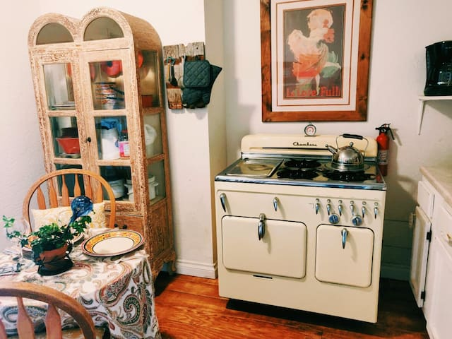 Cute food lovers' kitchen. Chamber's stove, microwave, coffee maker, lots of small appliances like popcorn maker, rice cooker, stew pot and more.