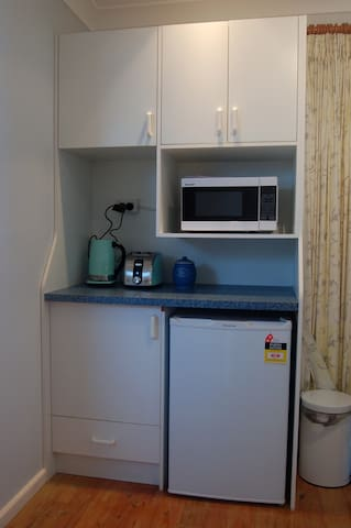 Kitchen amenities - microwave and fridge (with BBQ outside)