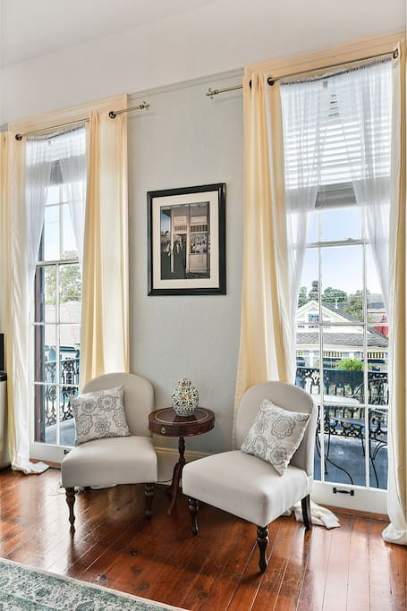 "10 ft windows open up to the balcony and are covered with 2"" decorative blinds, shears and drapes"