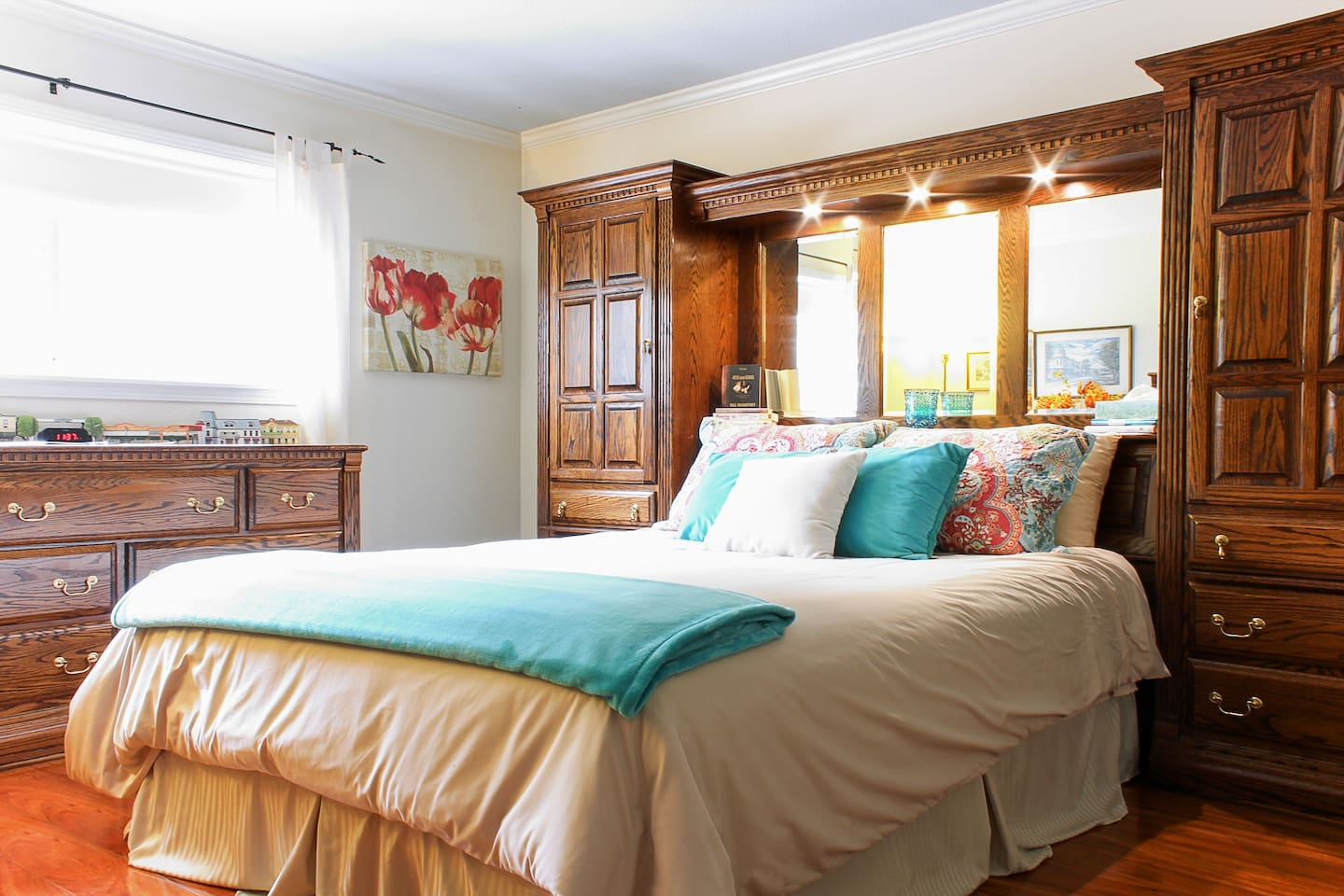 Comfortable Queen size bed with overhead dimmer switch reading lights.