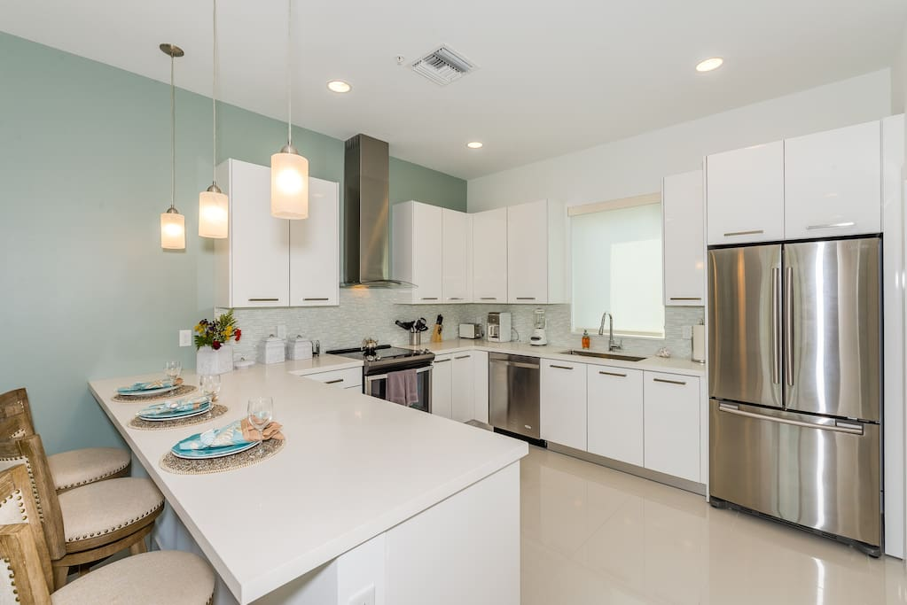 The well-equipped gourmet kitchen comes complete with stainless steel appliances