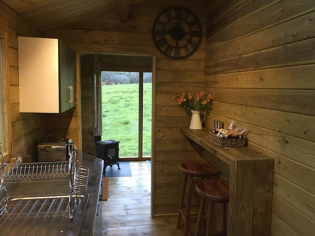 Fully equipped kitchen with small welcome hamper left on breakfast bar.