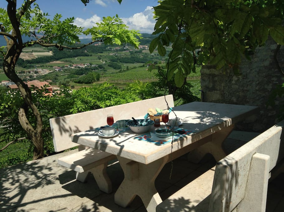 Marble benches and table on the terrace overlooking the valley.