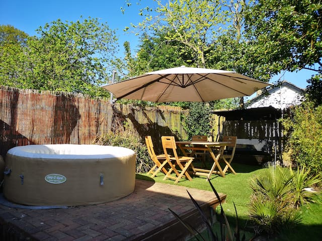 Hot tub, table and chairs and swung seat.