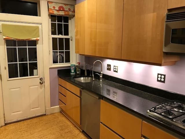 Kitchen with double oven, dishwasher and instant hot water