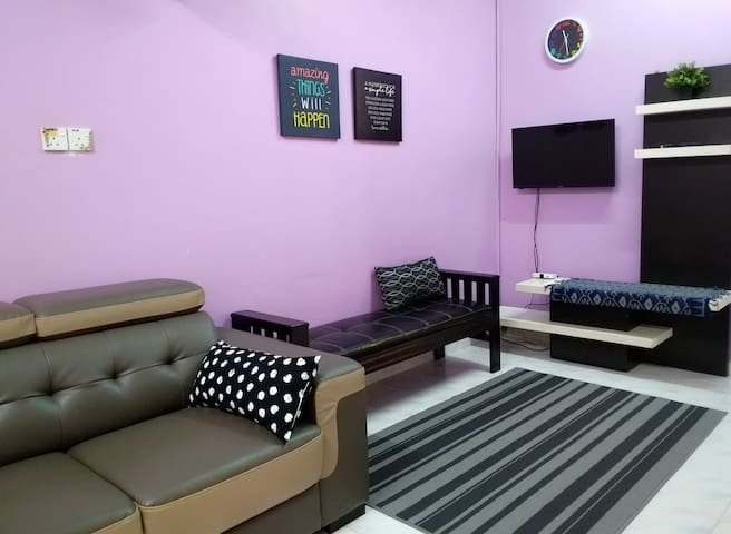 One L-shaped sofa, a bench, an LCD TV with MYTV.