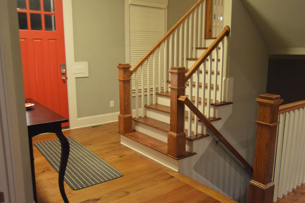Staircase to upper level and basement.