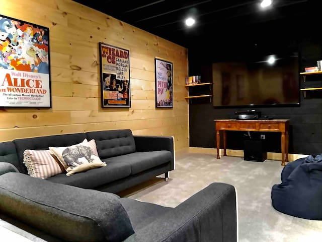 """Home Theater with 65"""" TV and 7-channel surround sound."""