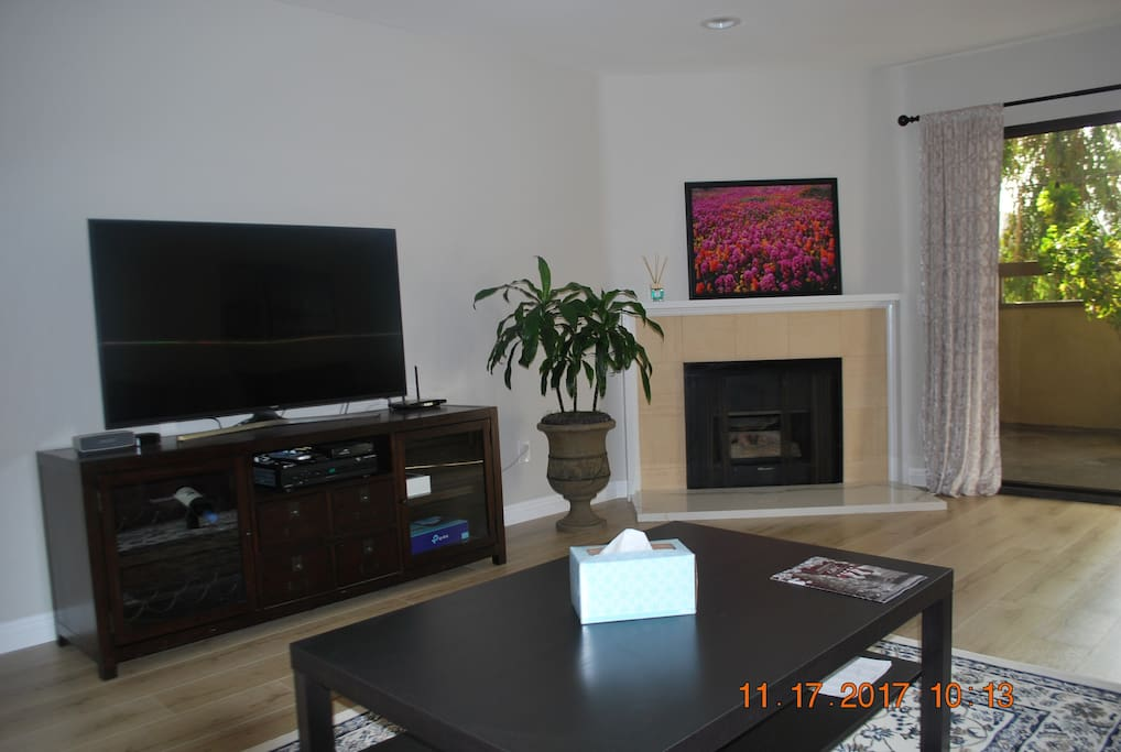 Relax & watch your favorite programs on this large screen TV