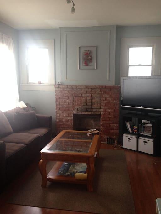 Living room w/large flat screen.