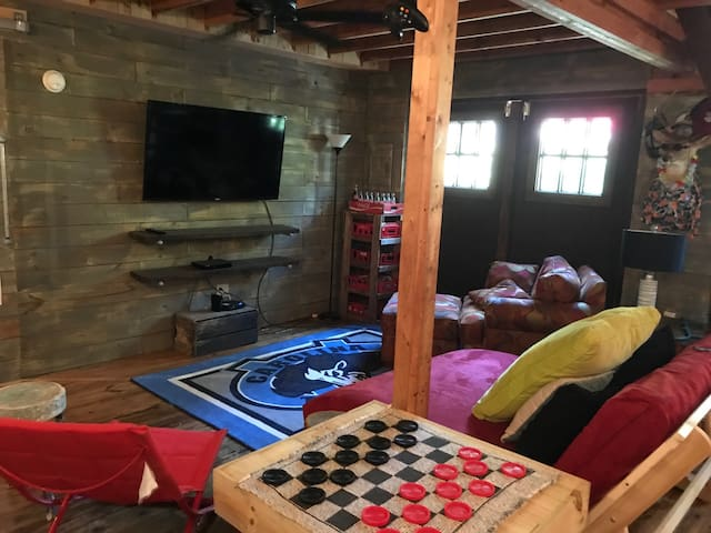 Great room to relax with games and large smart tv