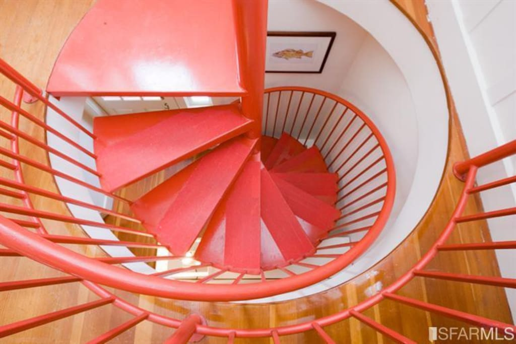Spiral stairs to 2 bedrooms and bathroom downstairs.