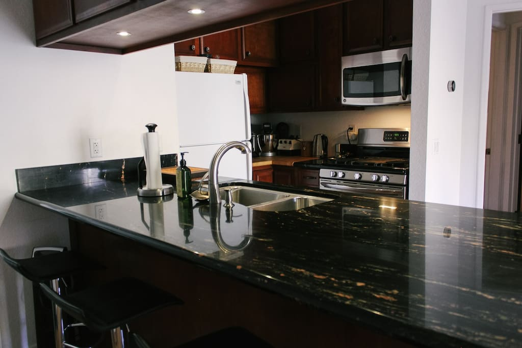 Enjoy cooking and eating at the beautiful granite counter top.
