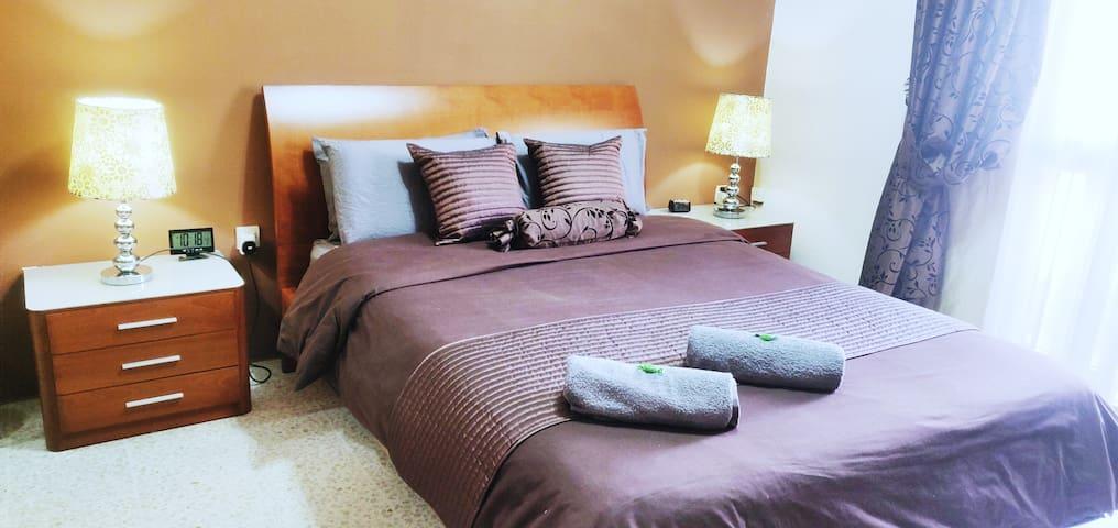Queen Bed Suite with TV, walkin wardrobe & balcony