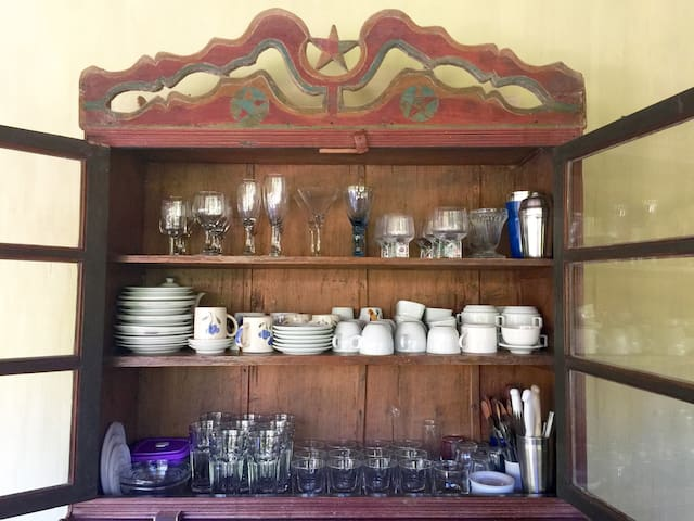a brazilian colonial cupboard with everything you will need