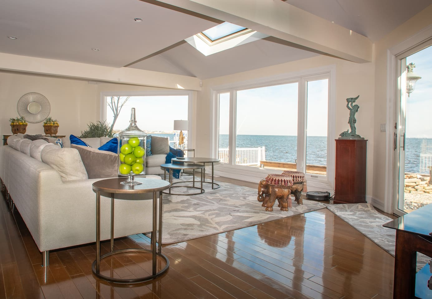 Family room facing LBI The Family Room is only 32 ft from the Bay!  You get beautiful views of the Bay from all angles.  Excellent for watching Sunrise or Sunset.  Sliding glass door opens to the back yard and patio.