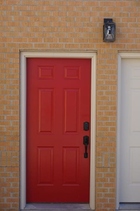 Red door highlights the entrance to the loft.