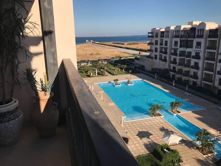 View from the balcony: the swimming pool and the beach