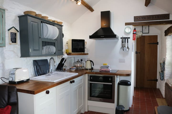 Well equipped kitchen area with oven, hob, microwave and dishwasher.