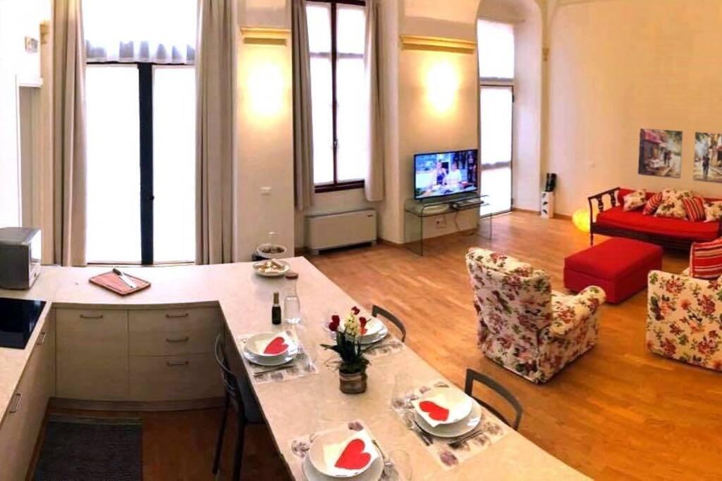 Open space con cucina e sala