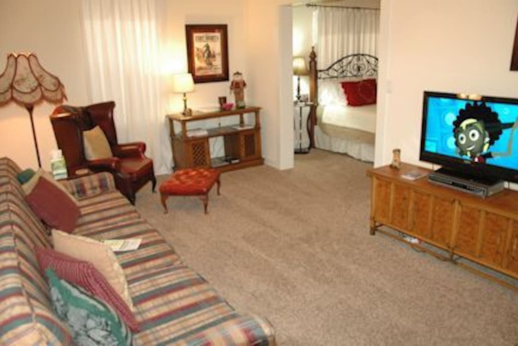 Living room with TV/Dish Network and WiFi.